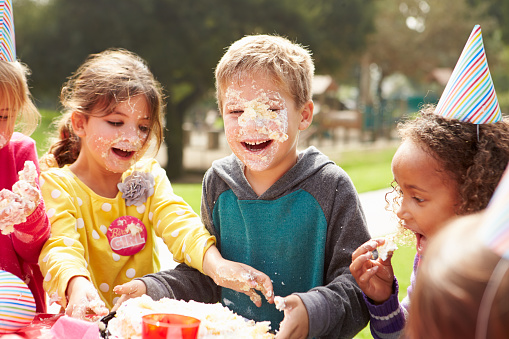 Group Of Children Having Outdoor Birthday Party Stock Photo - Download Image Now
