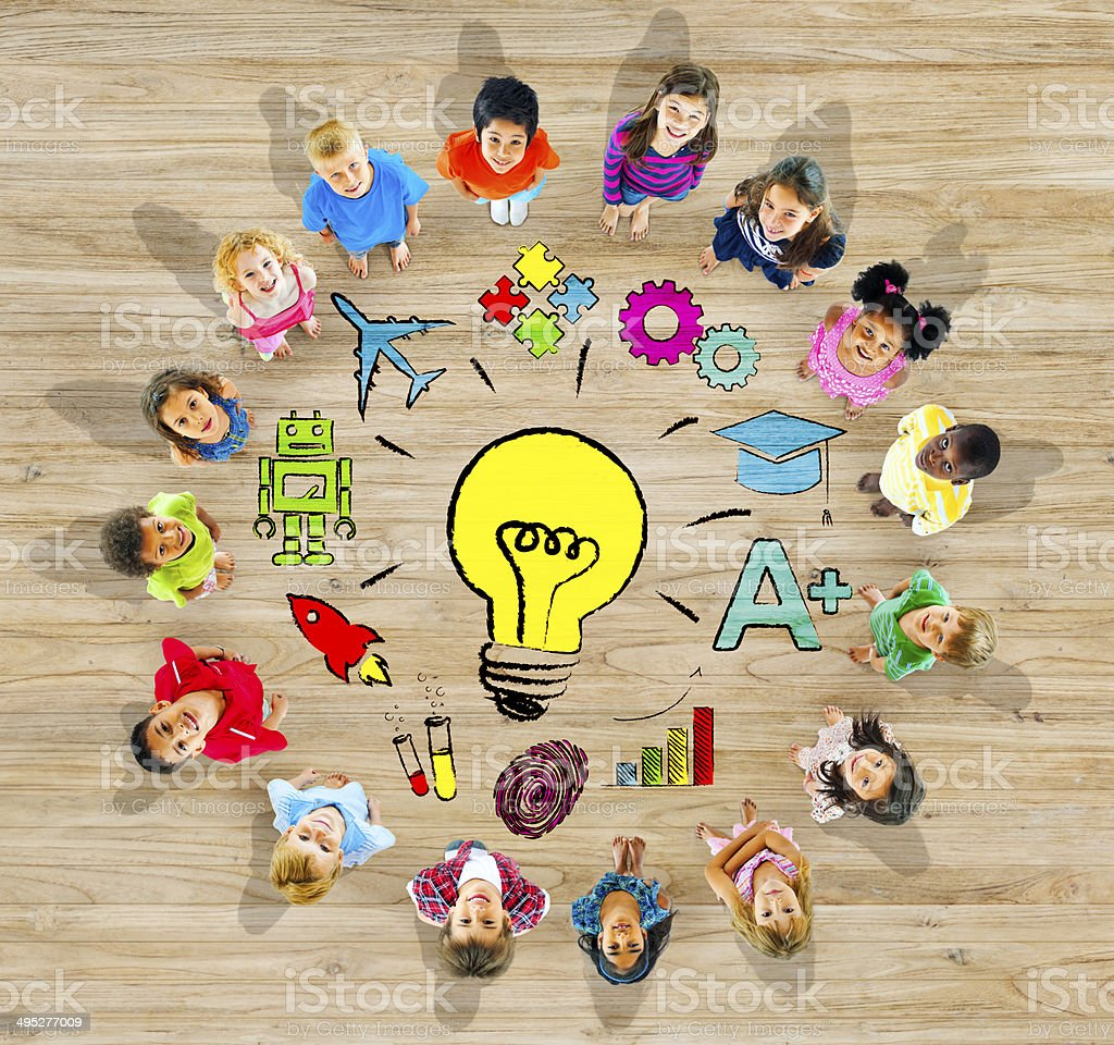 Group of Children in Circle with Light Bulb stock photo