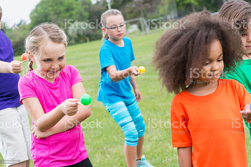 Group of children in egg spoon race stock photo