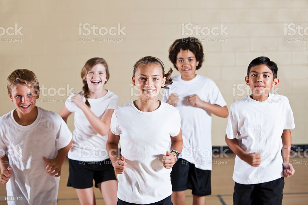 Group of children in phys ed class exercising royalty-free stock photo
