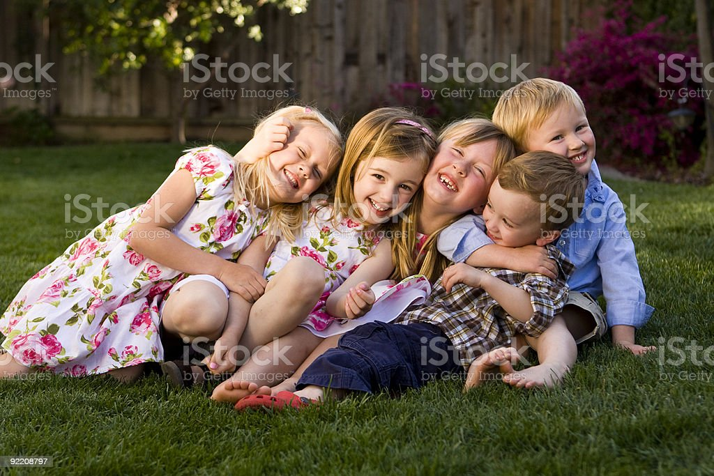 Group of Children Laughing, Hugging and Smiling stock photo