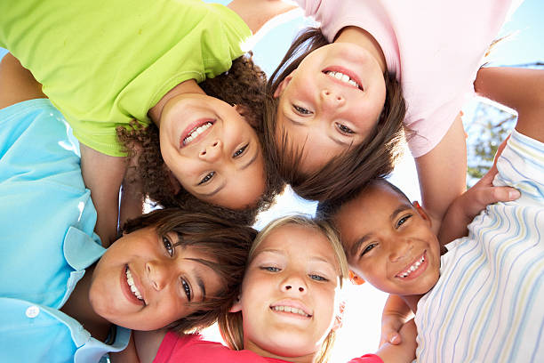 Group of Children Looking Down Into Camera stock photo