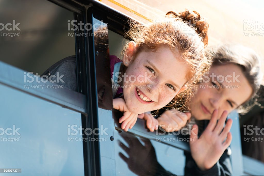 Group of Children looking out school bus window at school's out. zbiór zdjęć royalty-free
