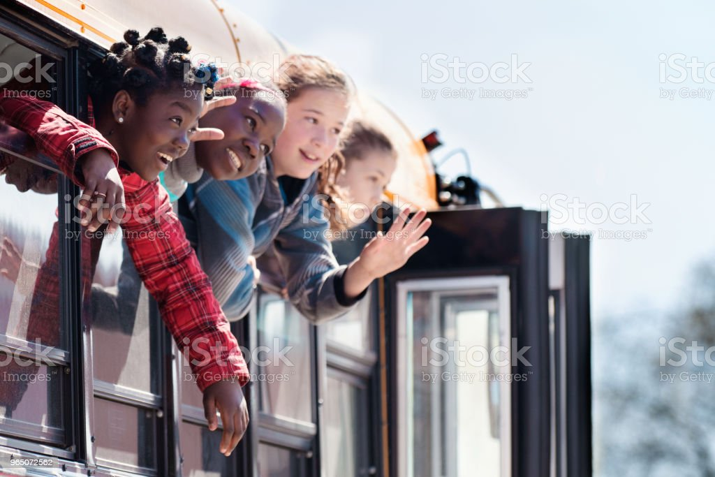 Group of Children looking out school bus window at school's out. royalty-free stock photo