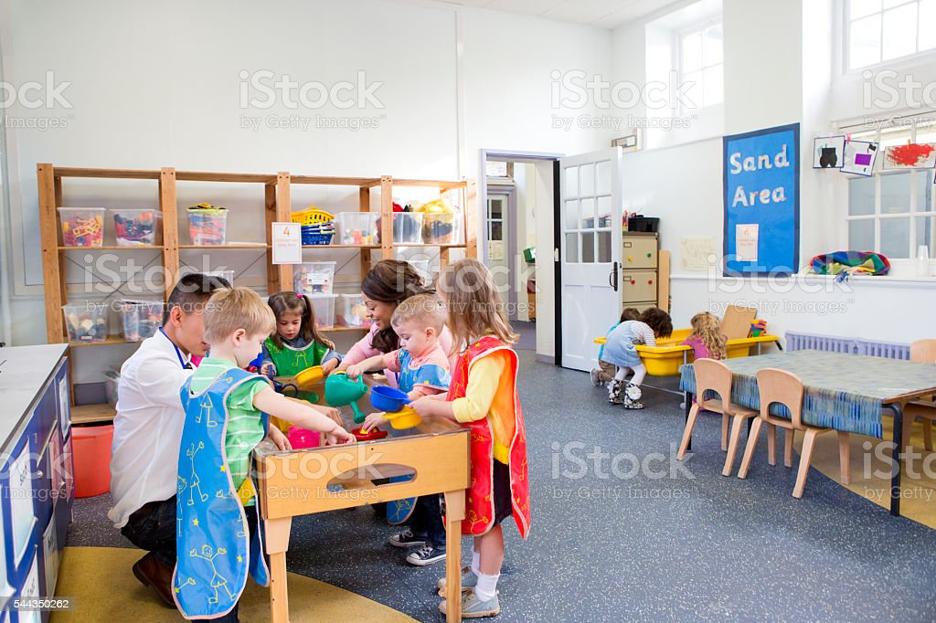Group of Children Playing in a Classroom stock photo