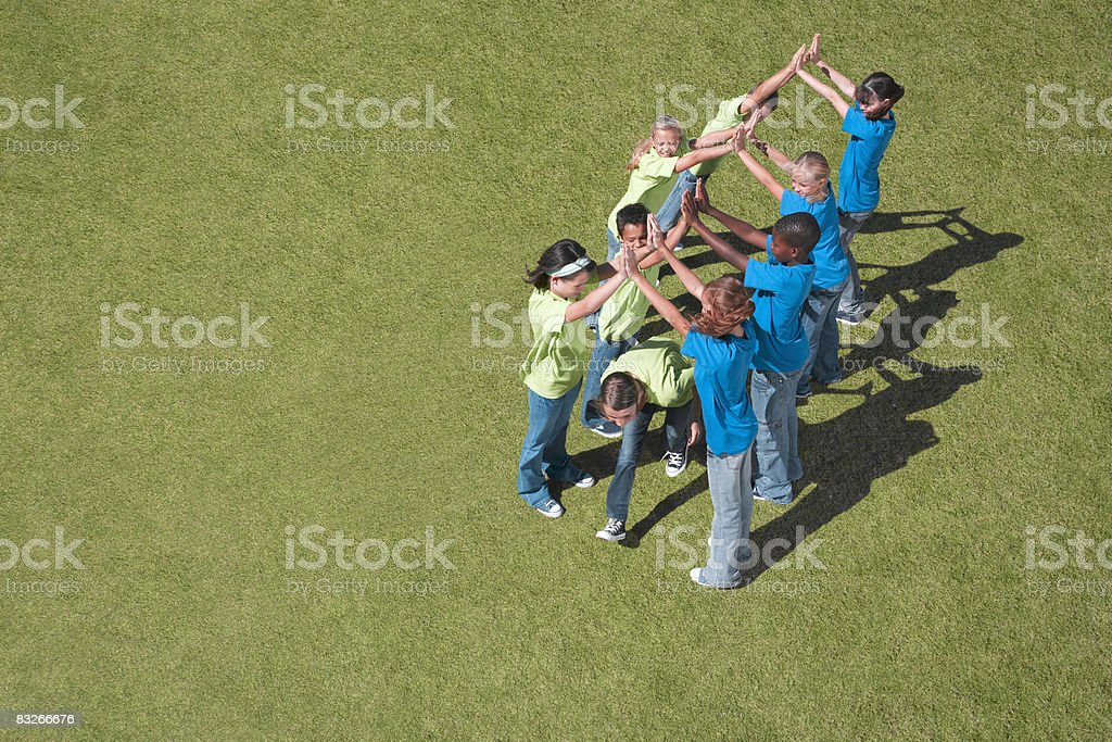 Group of children playing in park royalty free stockfoto