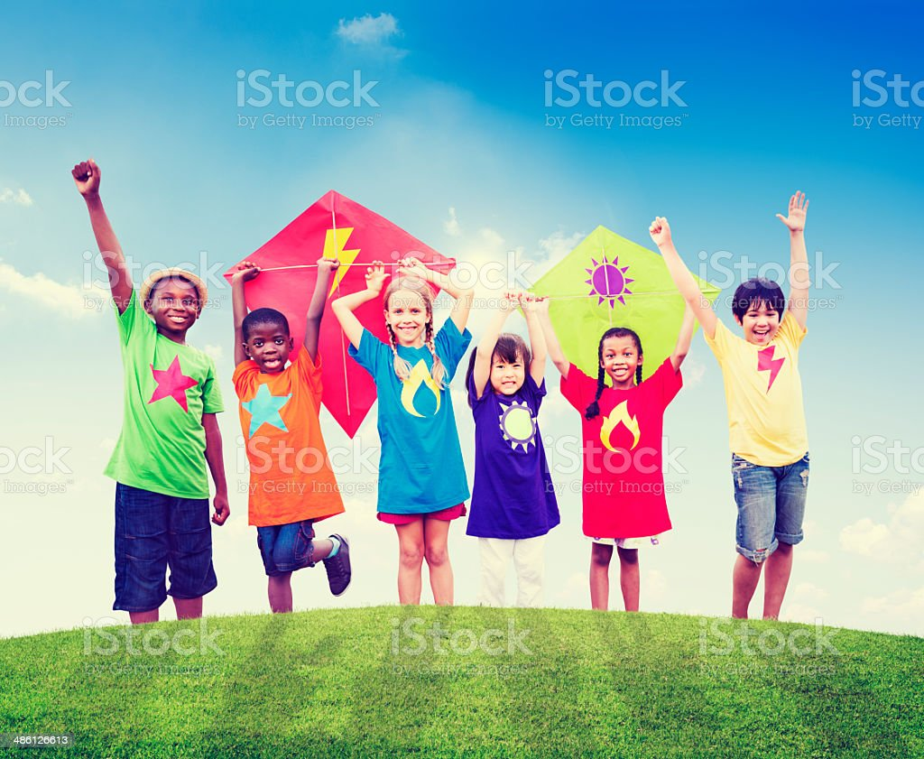 Group of Children Playing Kites Outdoors stock photo
