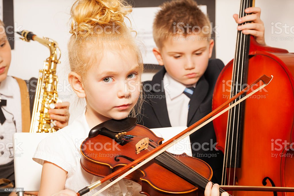 Group of children playing musical instruments stock photo
