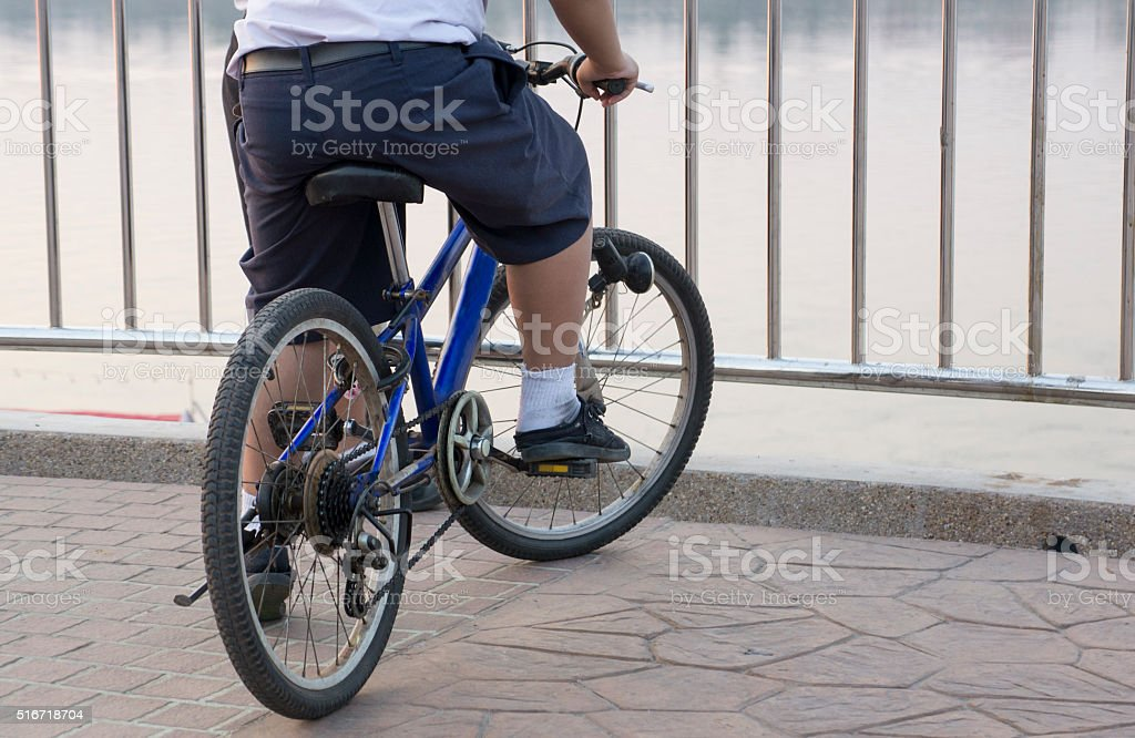group of children playing on bicycle stock photo