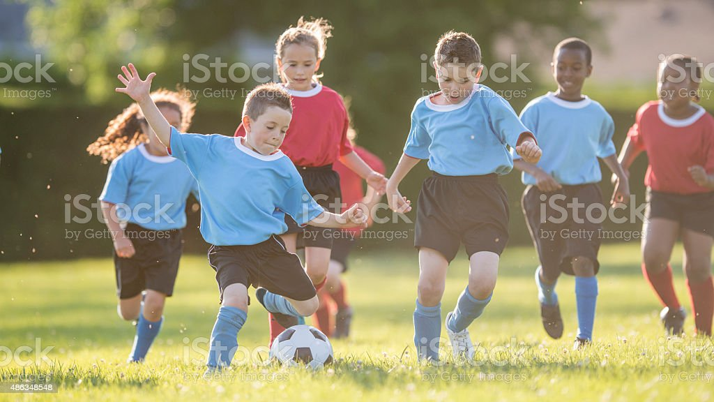 Group of Children Playing Soccer stock photo