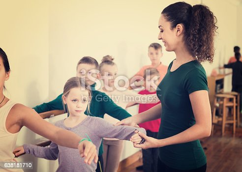 istock Group of children practicing at the ballet barre 638181710