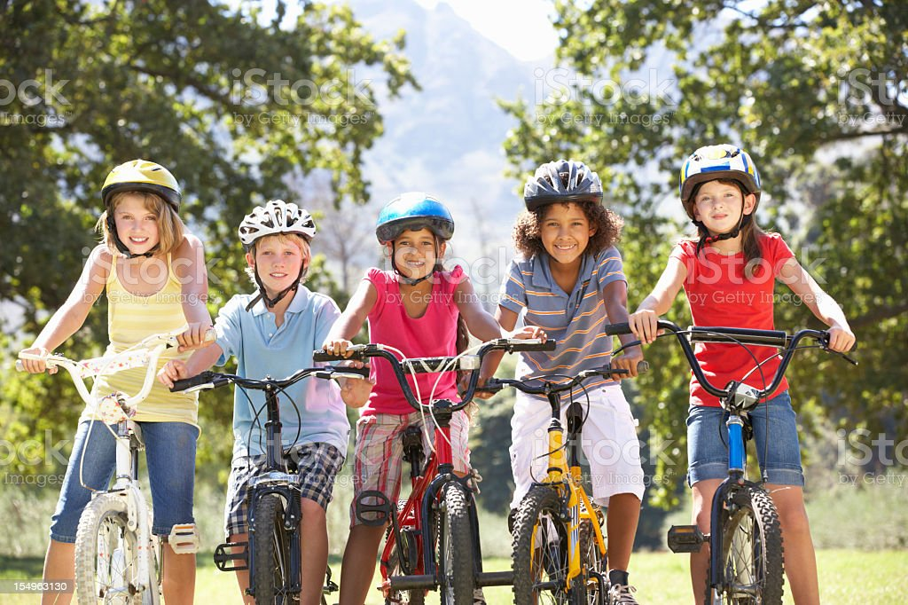 Group Of Children Riding Bikes In Countryside stock photo