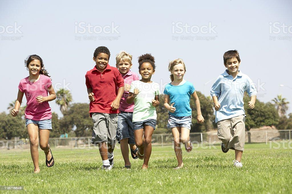 Group Of Children Running In Park stock photo