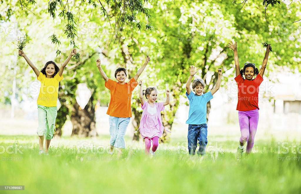Group of children running in the nature. royalty-free stock photo