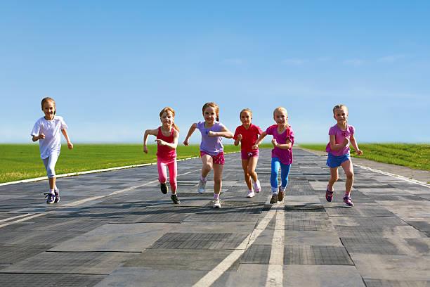 group of children running on the treadmill stock photo