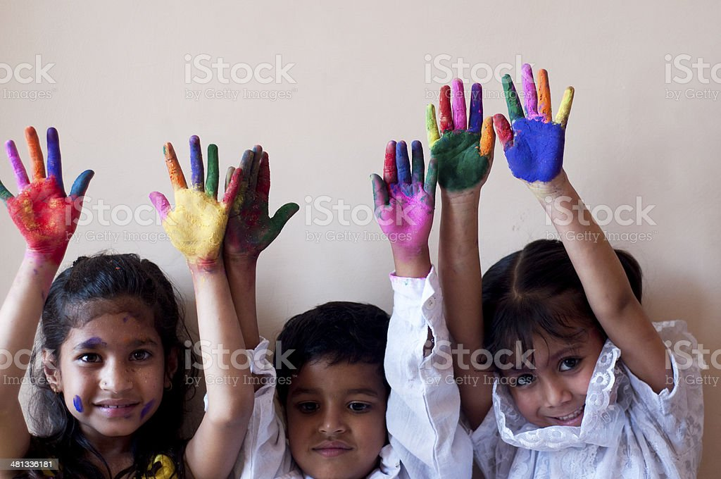 Group Of Children Showing Colorful Painted Hands Stock Photo