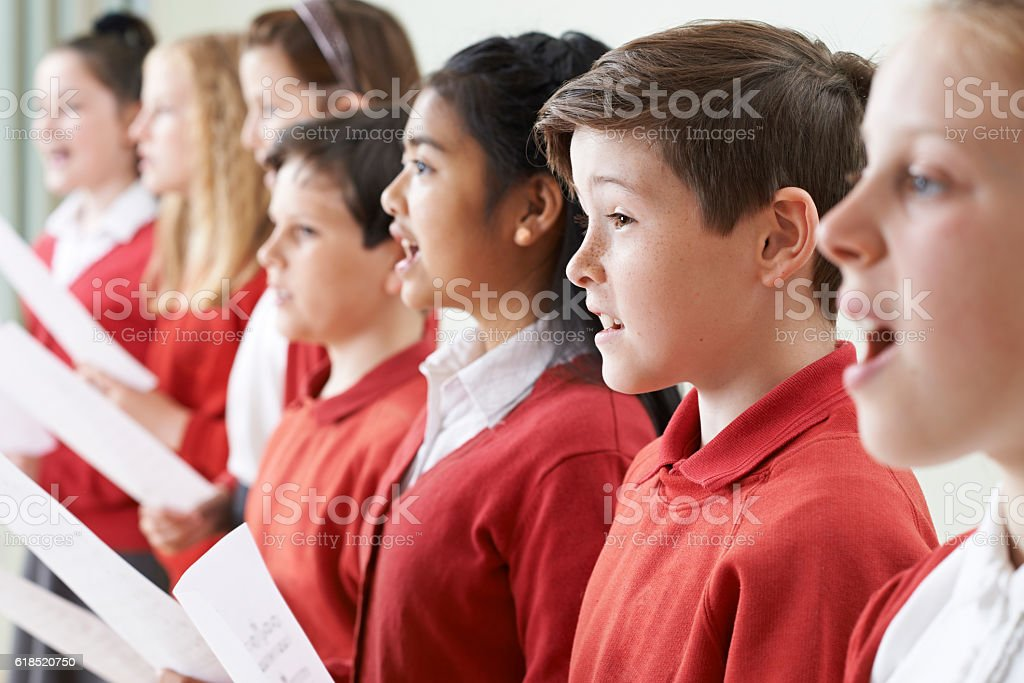 Group Of Children Singing In School Choir stock photo