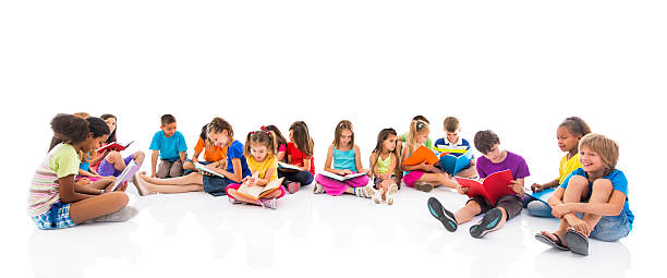 group of children sitting on floor and learning together. - sitting on floor stock photos and pictures