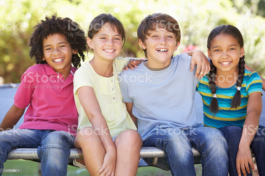 Group Of Children Sitting On Trampoline Together​​​ foto