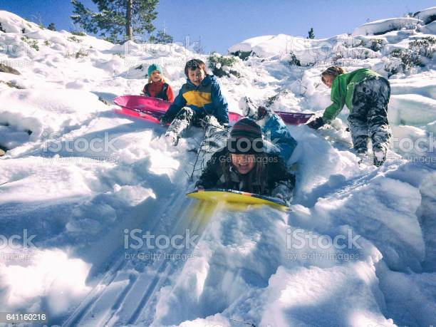 Group of children sledding together picture id641160216?b=1&k=6&m=641160216&s=612x612&h=wm0fudymbzggfmslxxjb7putdvru5ffptxjhcxkzlhe=