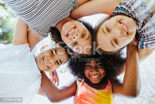 Group of children smiling and looking at the camera