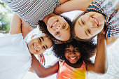 istock Group of children smiling and looking at the camera diversity 1270473756