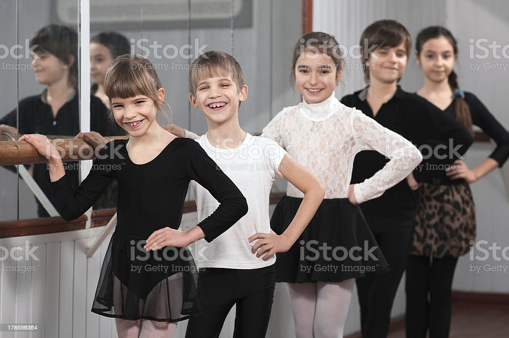 group of children standing at ballet barre stock photo