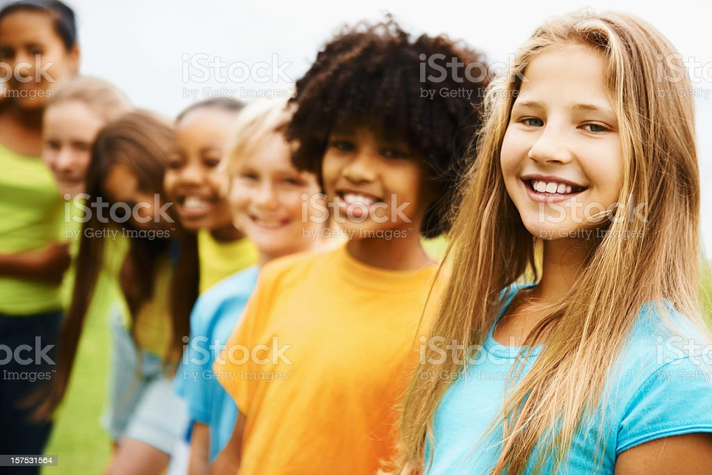 Group of children standing together stock photo