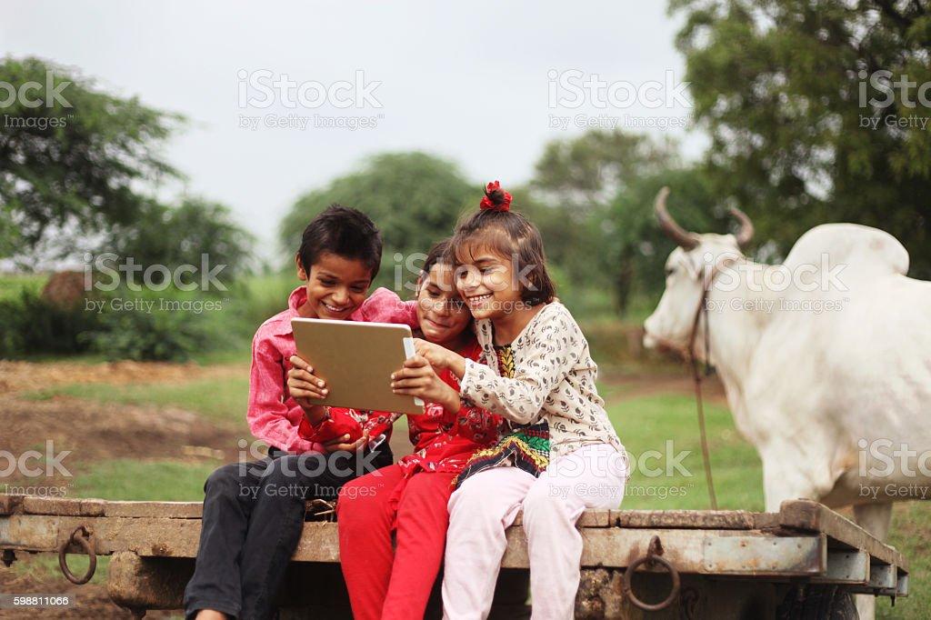 Group of children using digital tablet stock photo