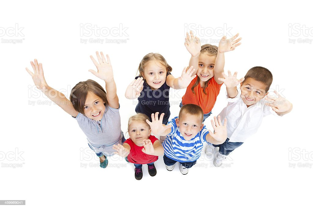Group of children with arms reaching high. stock photo