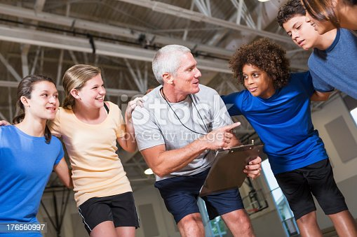 476098743 istock photo Group of children with coach in school gym 176560997