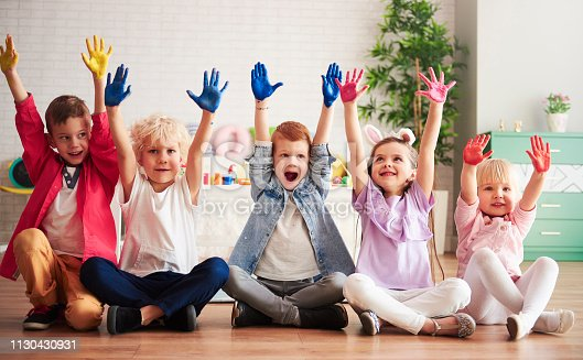 istock Group of children with colorful, painted hands 1130430931
