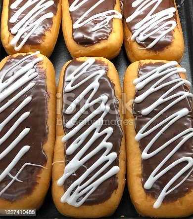 Delicious doughnuts covered with chocolate icing