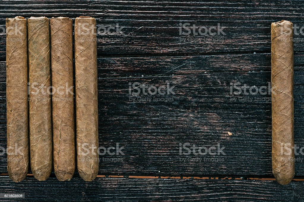 Group of cigars on the wood stock photo