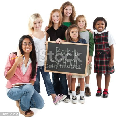 639569206 istock photo Group of Classmates With Teacher, Holding Back to School Sign 182922265