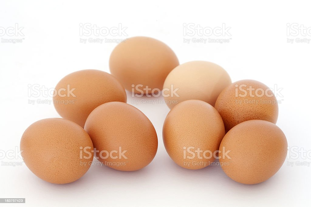 group of Clean brown eggs lying on white royalty-free stock photo