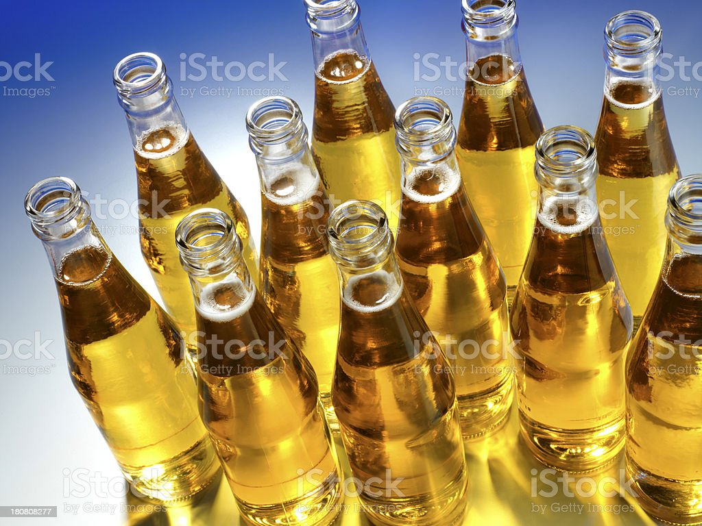 Group of Clear Beer bottles against a blue background stock photo