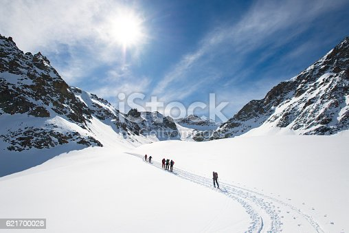 istock Group of climbers roped to the summit 621700028