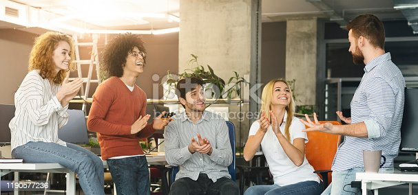 924520144 istock photo Group of colleagues applauding to new member of company 1190577236