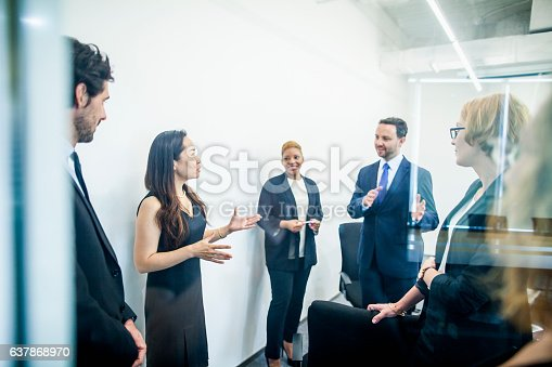 istock Group of colleagues having business meeting in office 637868970