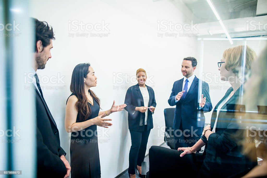 Group of colleagues having business meeting in office stock photo