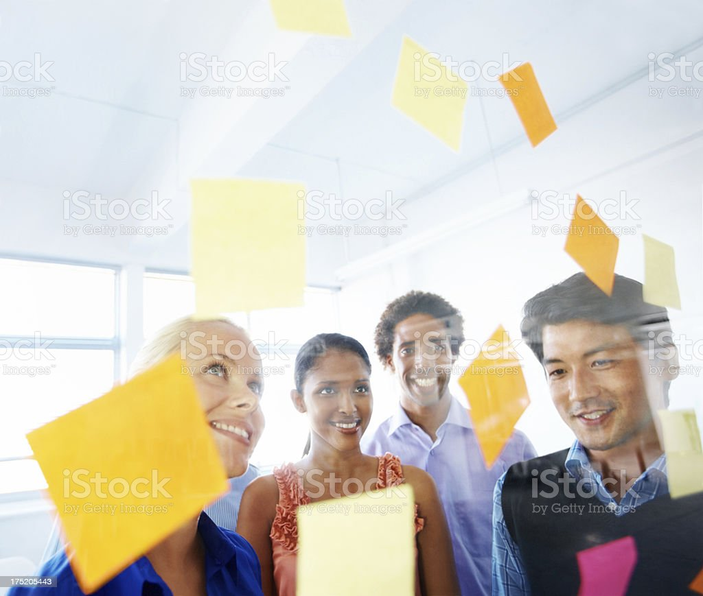 Group of colleagues letting ideas flow while brainstorming royalty-free stock photo