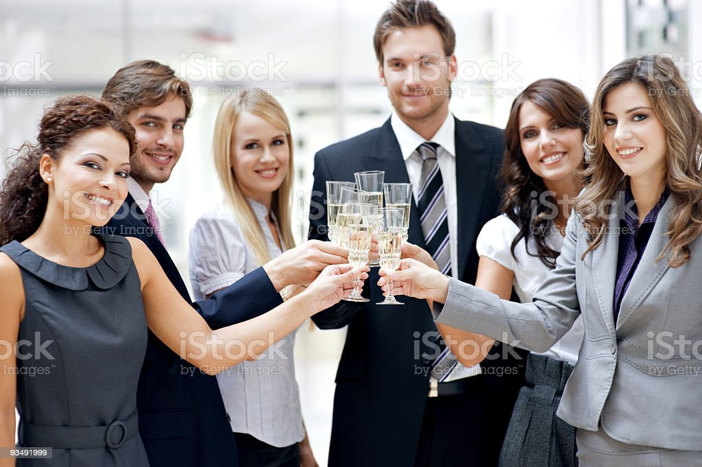 A group of colleagues making a toast royalty-free stock photo