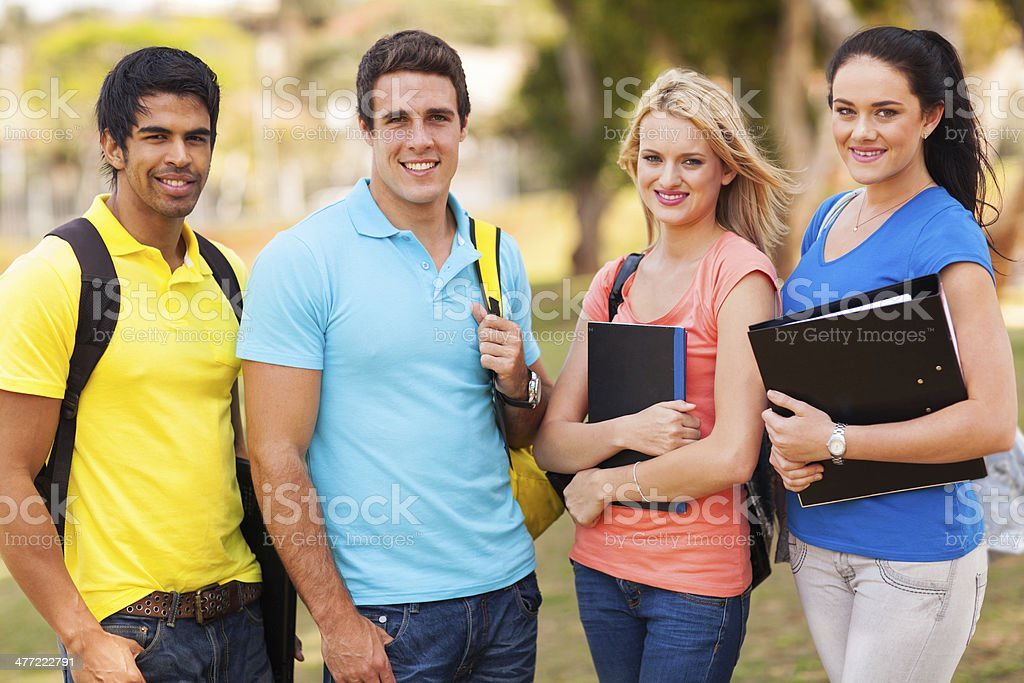 group of college friends on campus stock photo