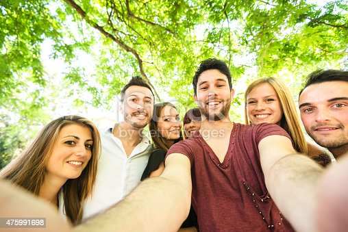 861023492istockphoto Group of college student laughing and doing a selfie 475991698