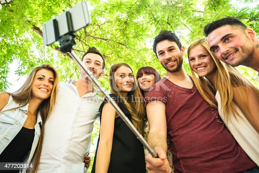 861023492istockphoto Group of college student laughing and doing a selfie 477203914