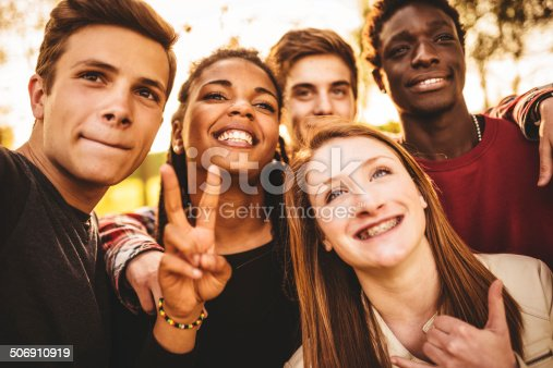 861023492istockphoto Group of college student laughing and doing a selfie 506910919