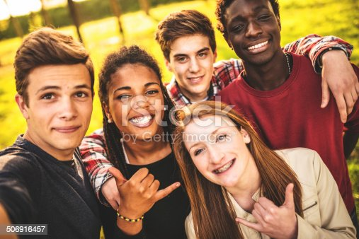 861023492istockphoto Group of college student laughing and doing a selfie 506916457
