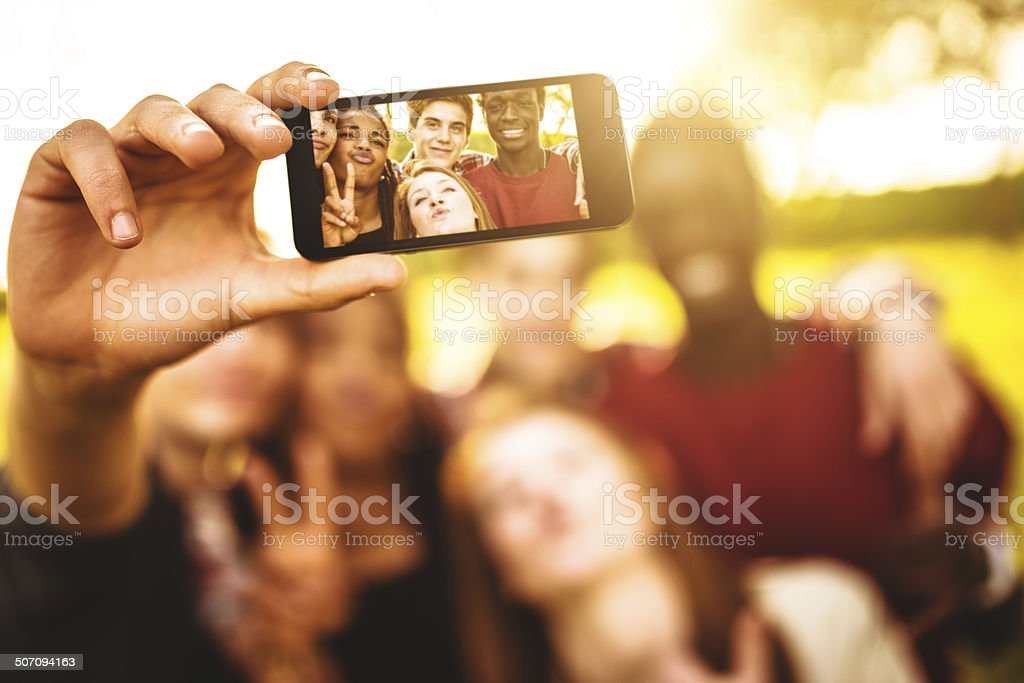 Group of college student laughing and doing a selfie royalty-free stock photo
