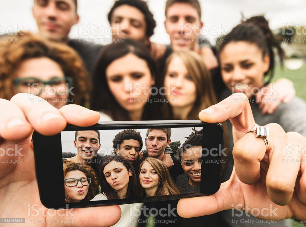 Group of college student laughing and doing a selfie stock photo